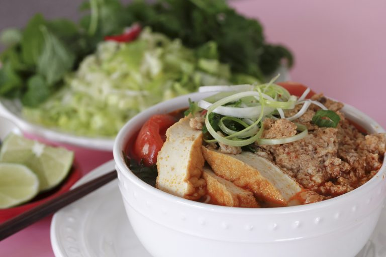 Vietnamese Traditional Food: Meat rice vermicelli soup, served with tomato broth and topped with crab or shrimp paste.