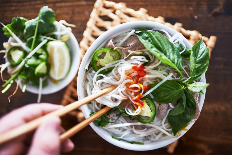 beef pho saigon with spicy sriracha sauce